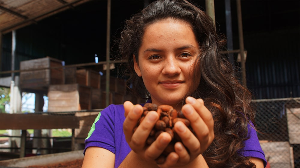 Maria is learning sustainable methods to grow cocoa.