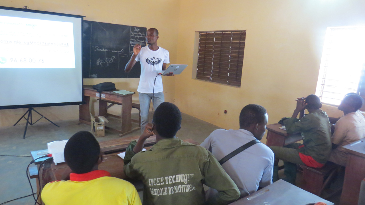 Youths in Natitingou receive an information session at the Lycée Technique Agricole